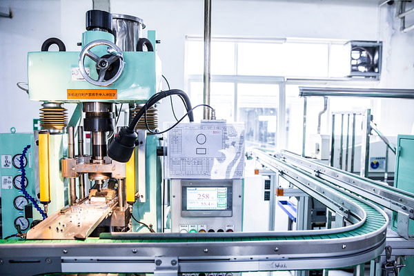 production line of magnets and small metal parts